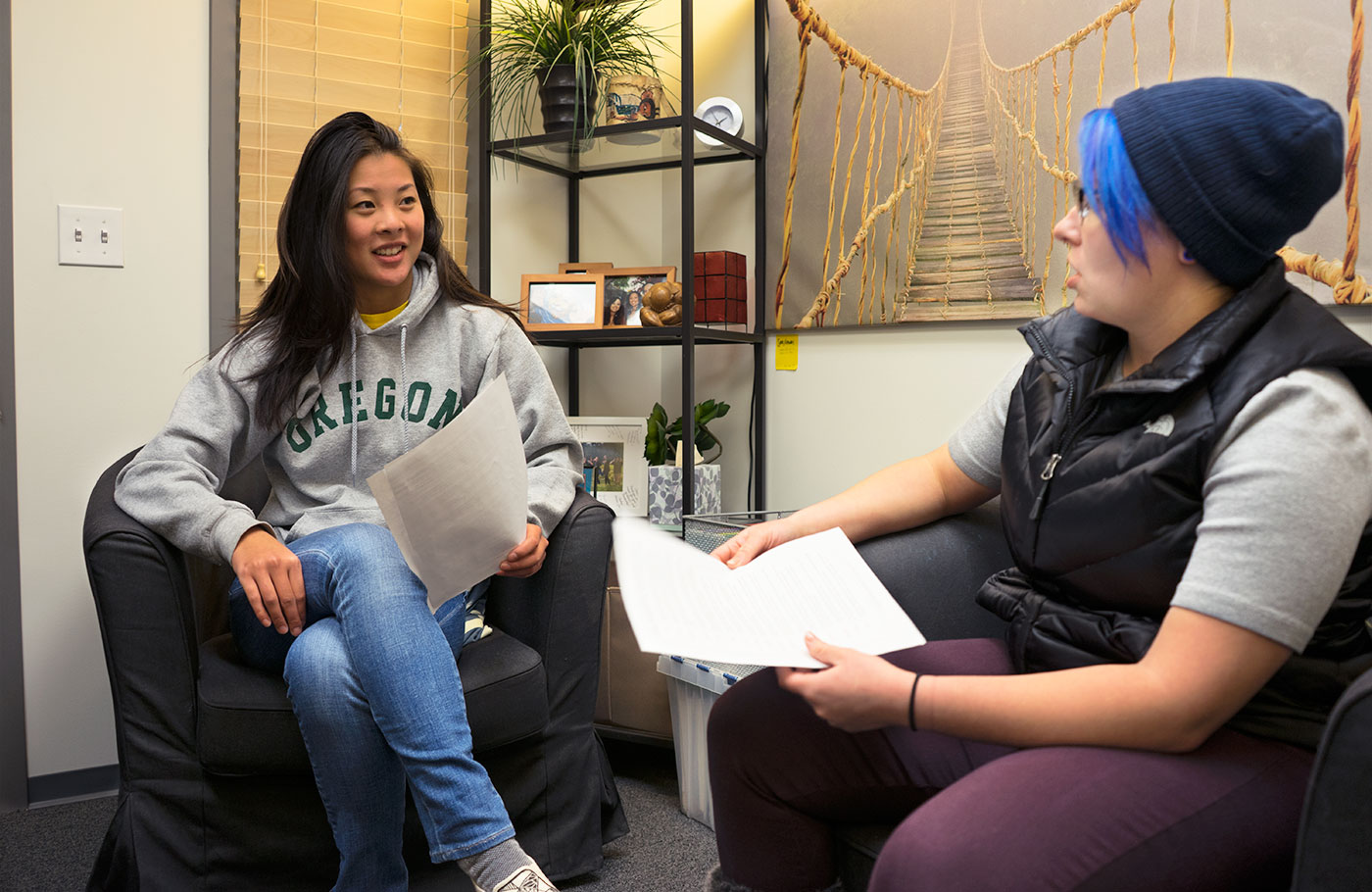 A student meeting with a student intern to review their strengths results in an office in the Holden Center.